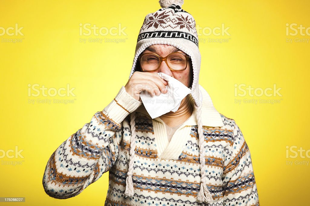 Young Man With Tissue and Cold Virus Blowing Nose royalty-free stock photo