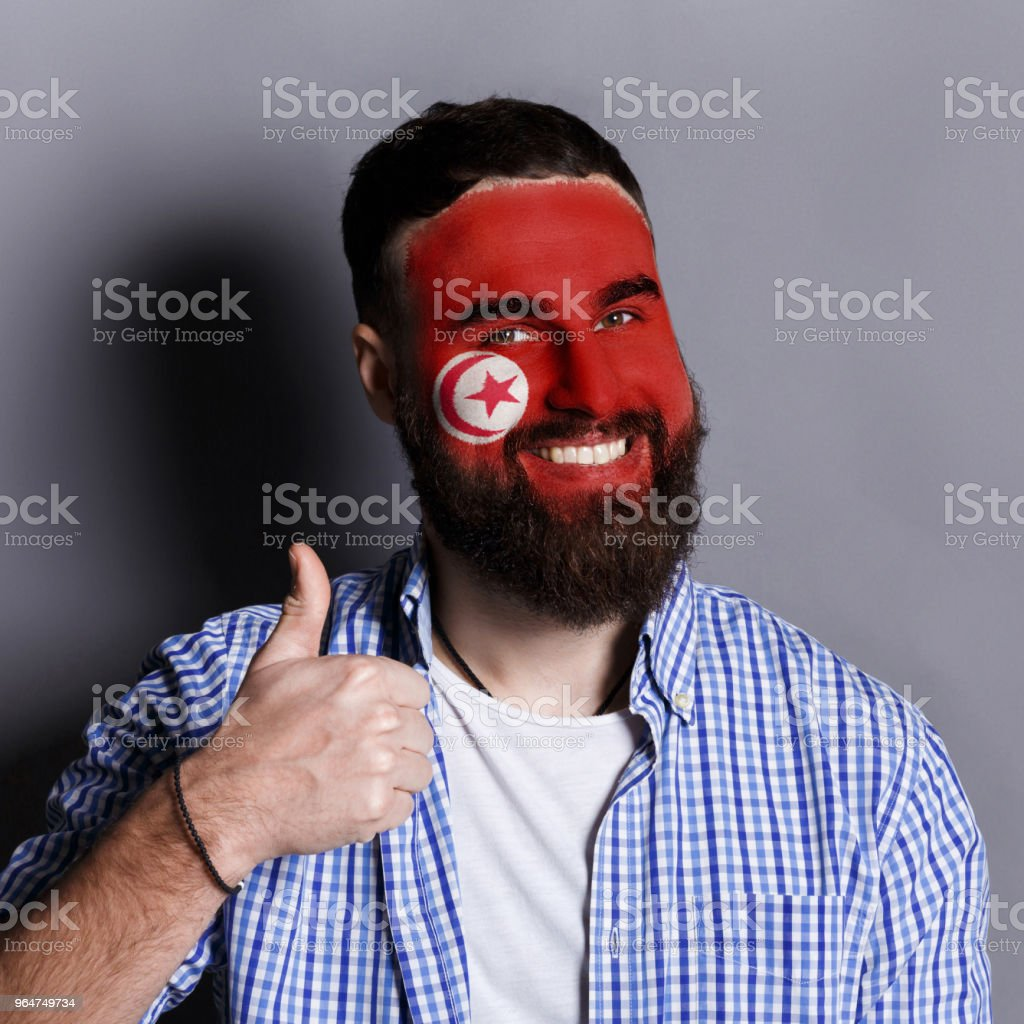 Young man with Tunis flag painted on his face royalty-free stock photo