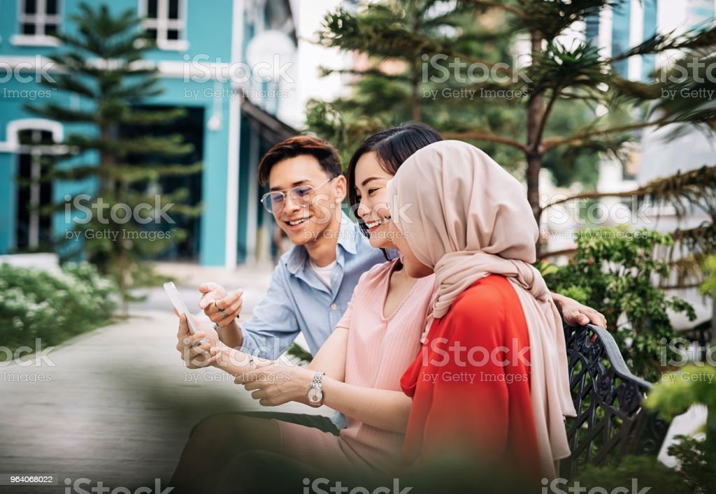 Young man with two beautiful women in Asia - Royalty-free 20-29 Years Stock Photo