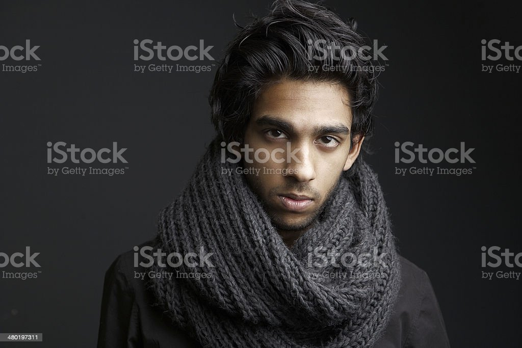Young man with wool scarf stock photo
