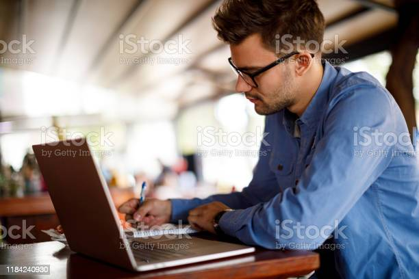 Young man working at a cafe picture id1184240930?b=1&k=6&m=1184240930&s=612x612&h=uupmlu4cfxaic7lt4t9ykiws0vtsk mpogfh6gyppqa=