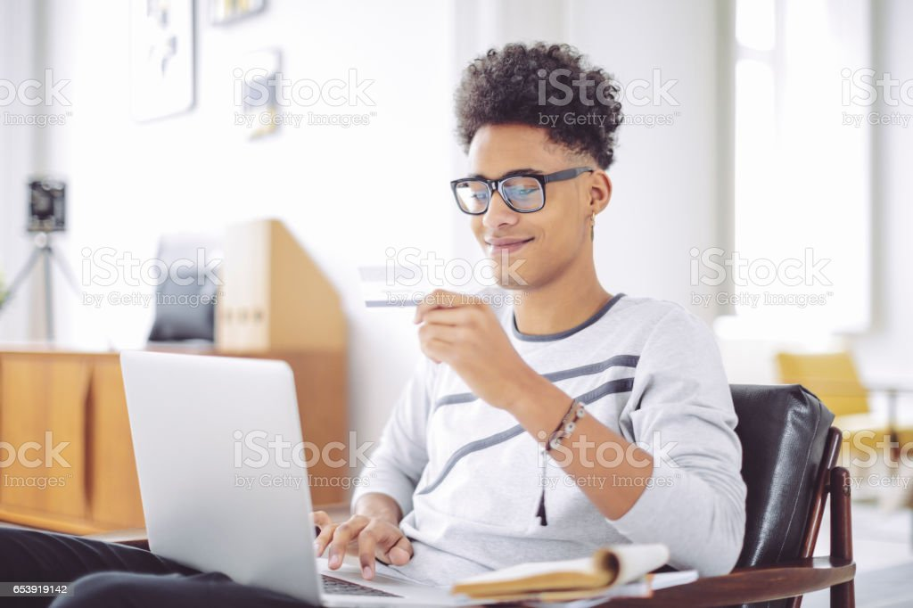 Young man working at home office stock photo