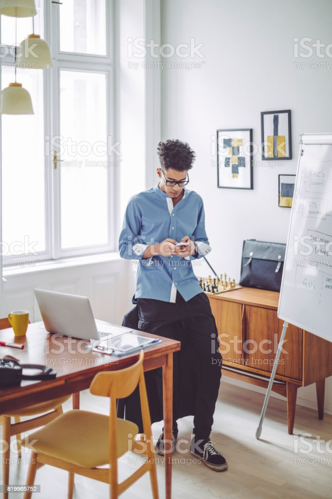young man working at home office royalty free stock photo - Working In Home Office