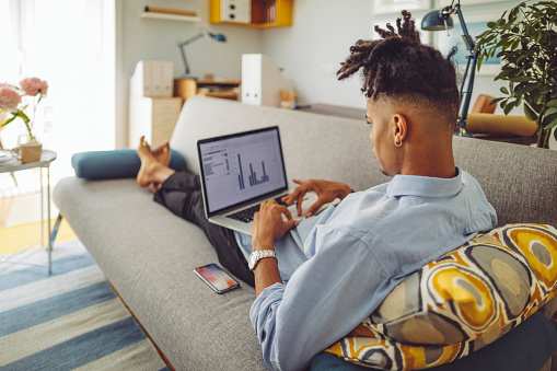 istock Young man working at home 1155255759