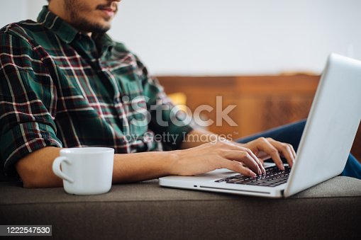 1083827722 istock photo Young man working at home 1222547530