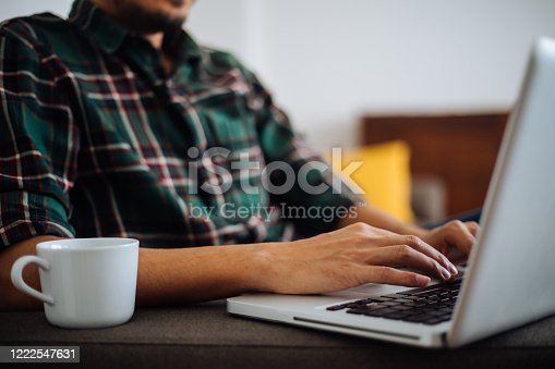 1083827722 istock photo Young man working at home 1222547631