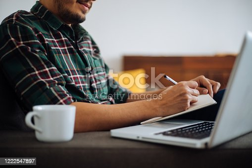 1083827722 istock photo Young man working at home 1222547897