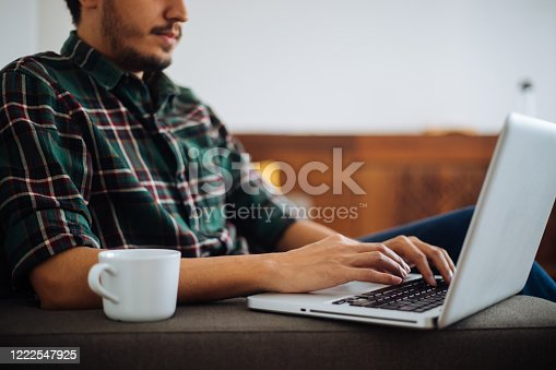 1083827722 istock photo Young man working at home 1222547925