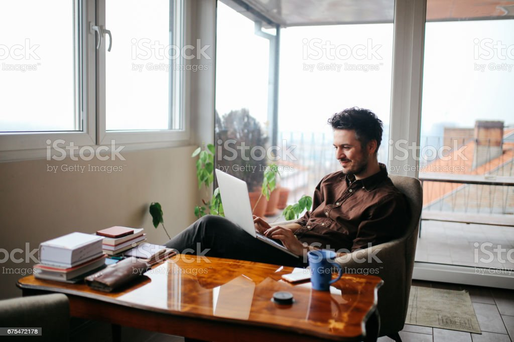 Young man working at home stock photo