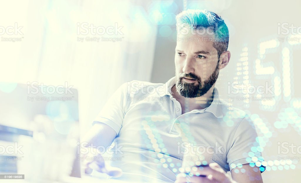 young man working, double exposure with financial numbers stock photo
