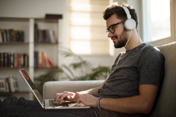 Young man working from home stock photo