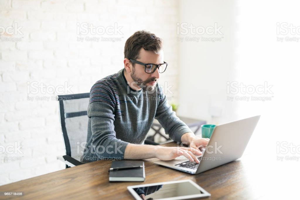 Young man working from home - Royalty-free 30-39 Years Stock Photo