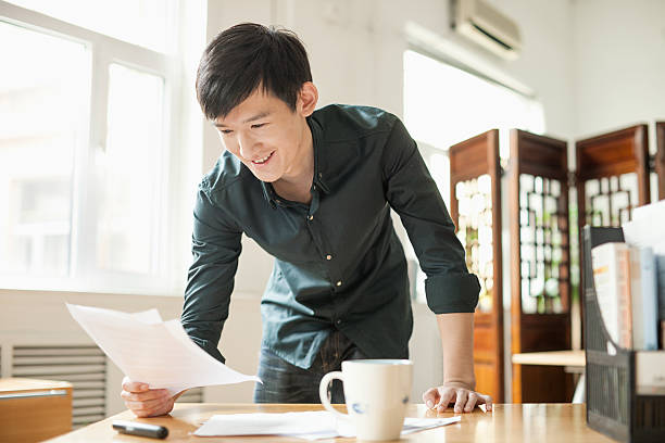 Young Man Working in Creative Office stock photo