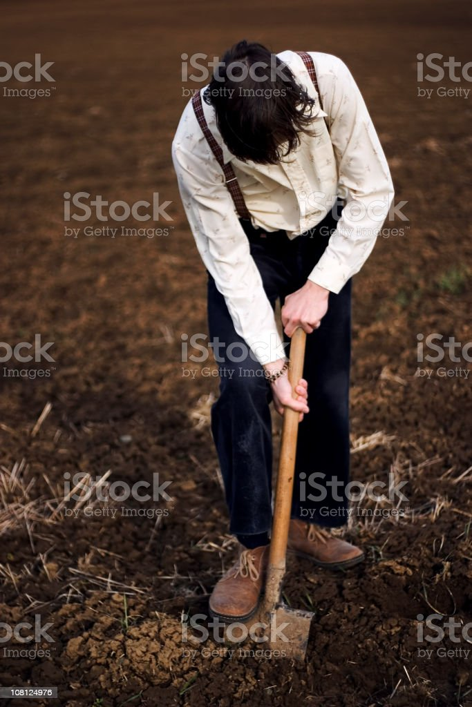 Young Man Working in field royalty-free stock photo