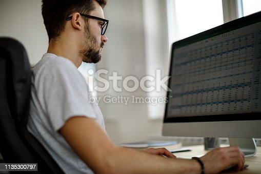 872006502 istock photo Young man working in his office 1135300797