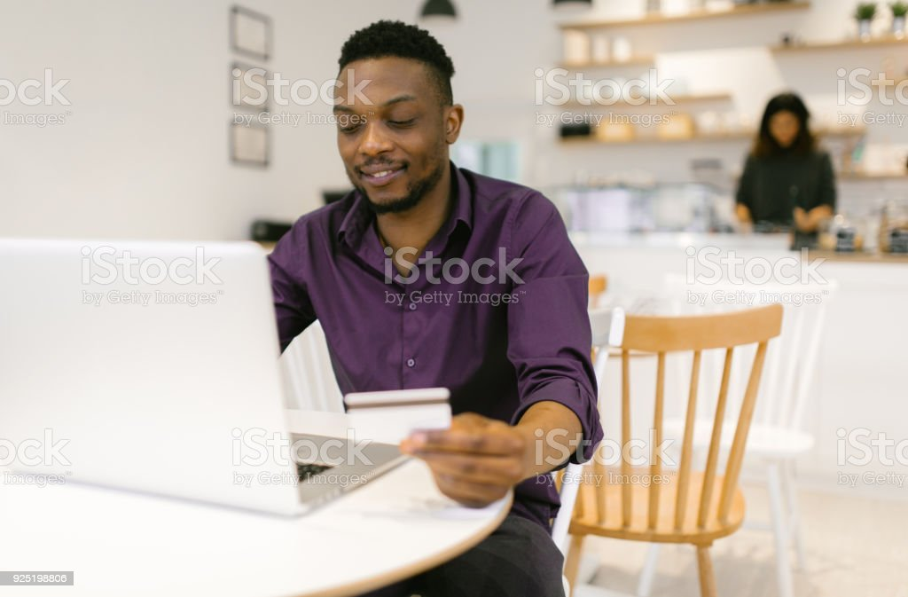 Young man working in the coffee bar stock photo