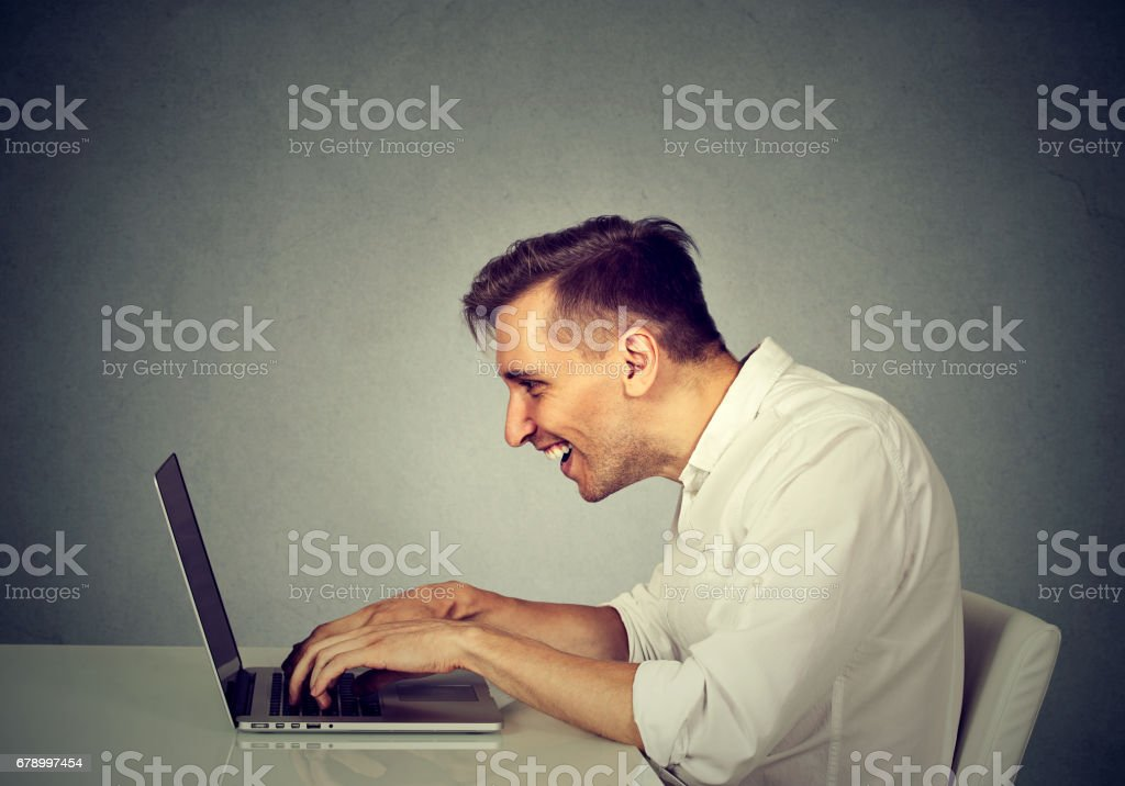 young man working on computer royalty-free stock photo