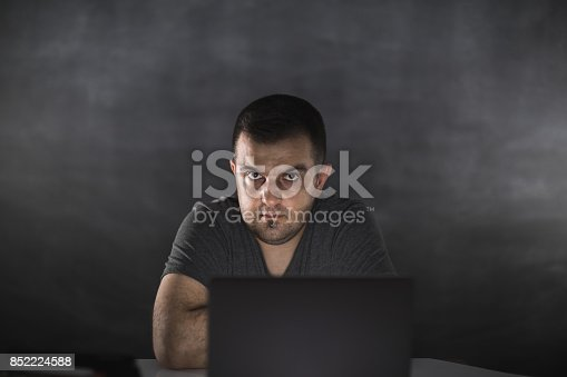 1022150556 istock photo Young man working on computer 852224588