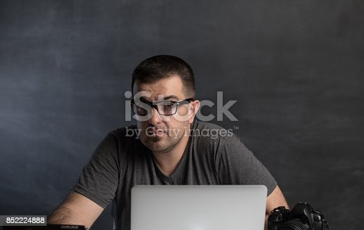 1022150556 istock photo Young man working on computer 852224888