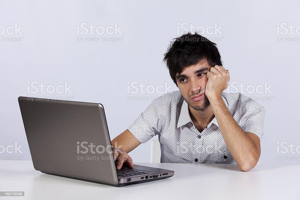 Young man working on his laptop royalty-free stock photo