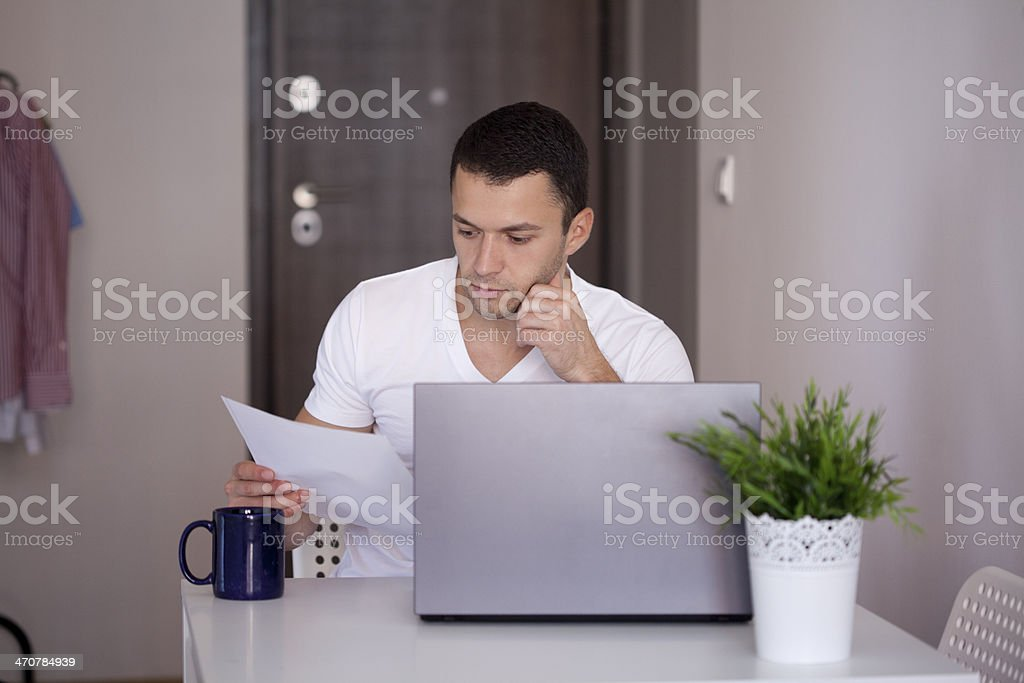 young man working on lap top royalty-free stock photo