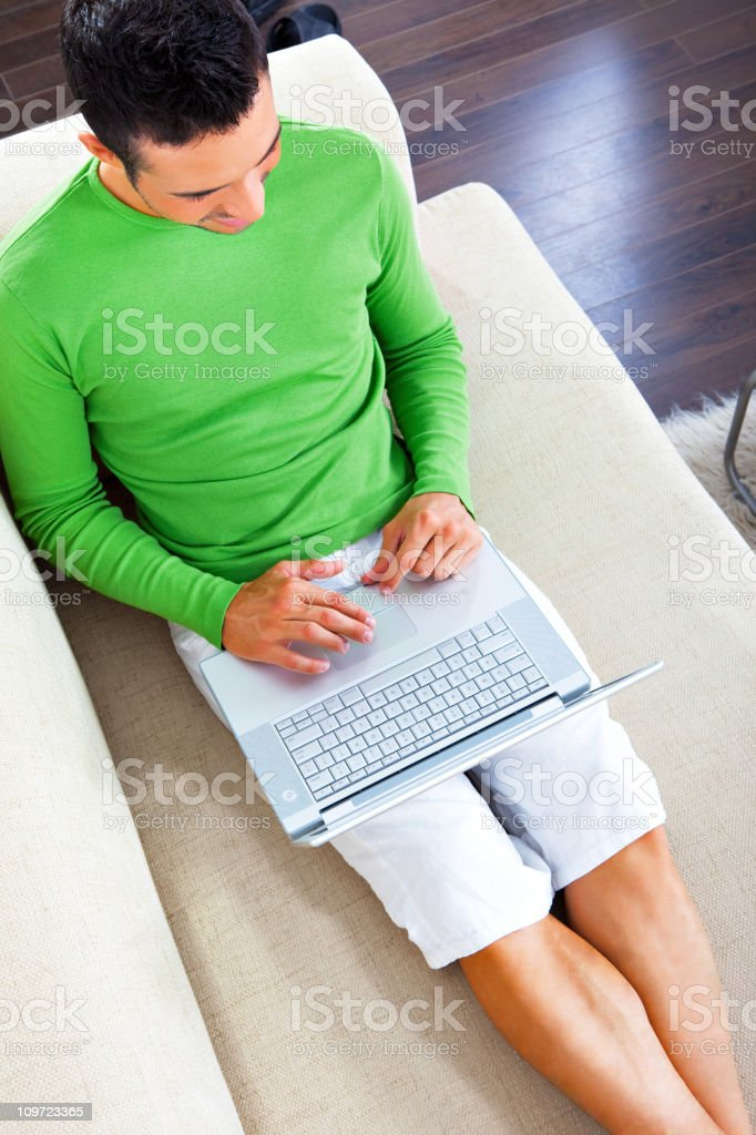 Young man working or studying at home stock photo