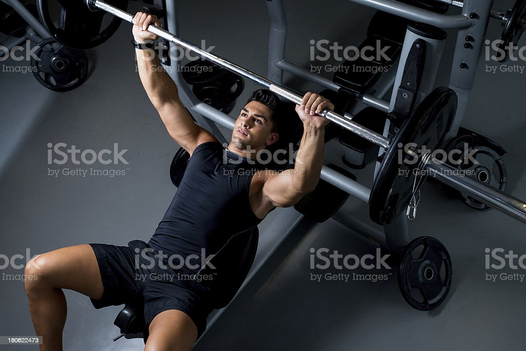 Young Man Working Out in the Gym stock photo