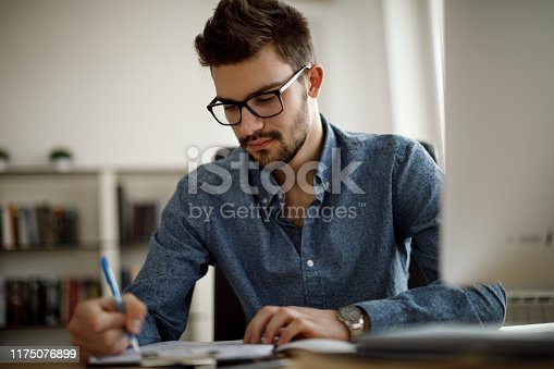 1083827722 istock photo Young man working 1175076899
