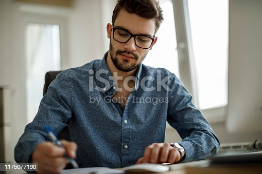 1083827722 istock photo Young man working 1175077190