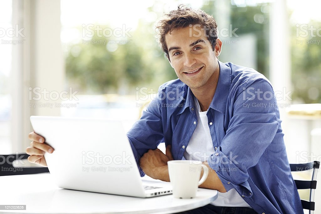 Young man working with laptop royalty-free stock photo