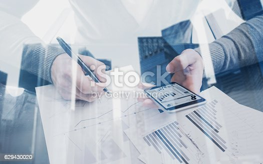 629421870 istock photo Young man working with modern smartphone in coworking place.Concept 629430020