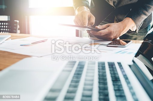 Young man working with tablet, man's hands on tablet computer, business person at workplace