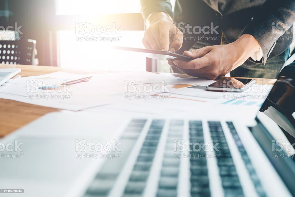 Young man working with tablet, man's hands on tablet computer, business person at workplace stock photo