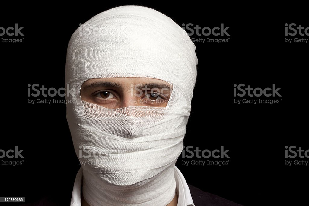 Young Man Wrapped in Bandage stock photo