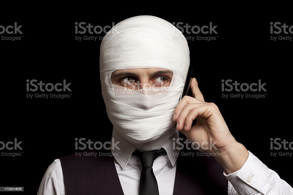 Young Man Wrapped in Bandage Use Mobile Phone royalty-free stock photo