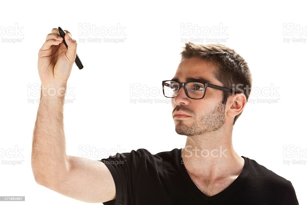 Young man writing on transparent board royalty-free stock photo
