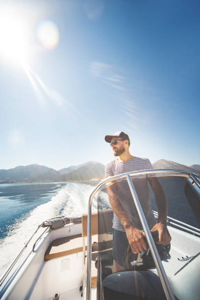 Young man yachting alone stock photo