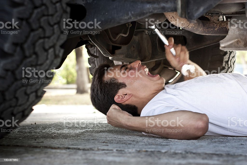 Young Man Yelling at Vehicle stock photo