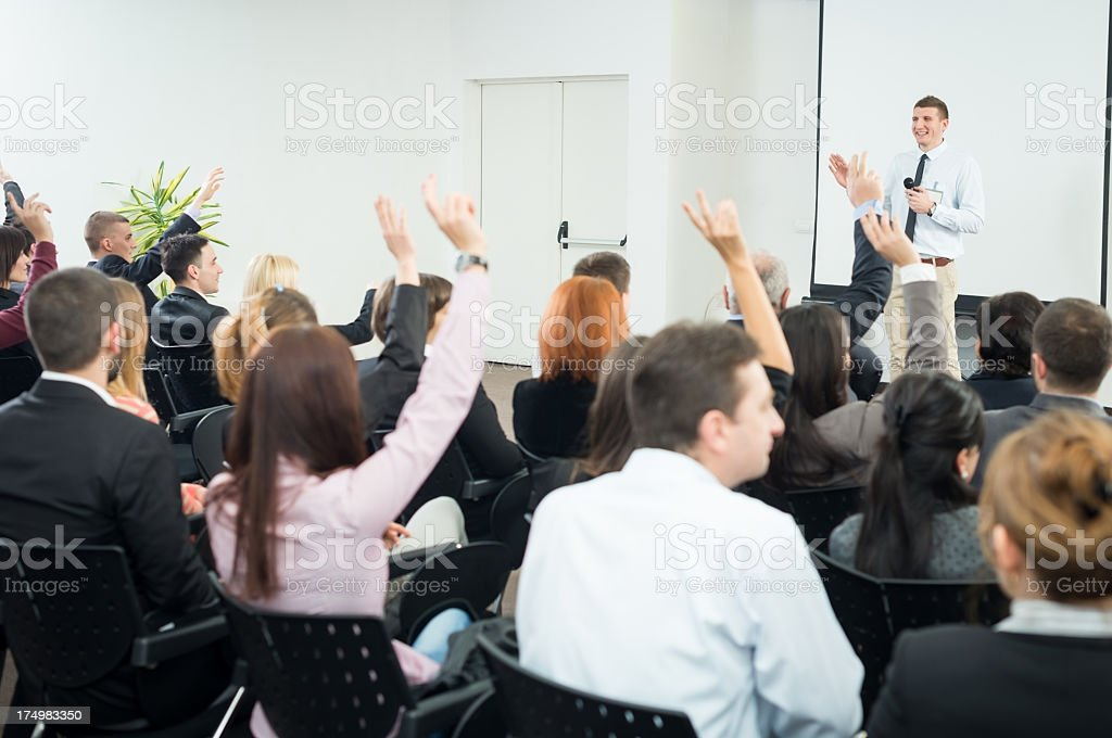 Young Manager answering the questions stock photo