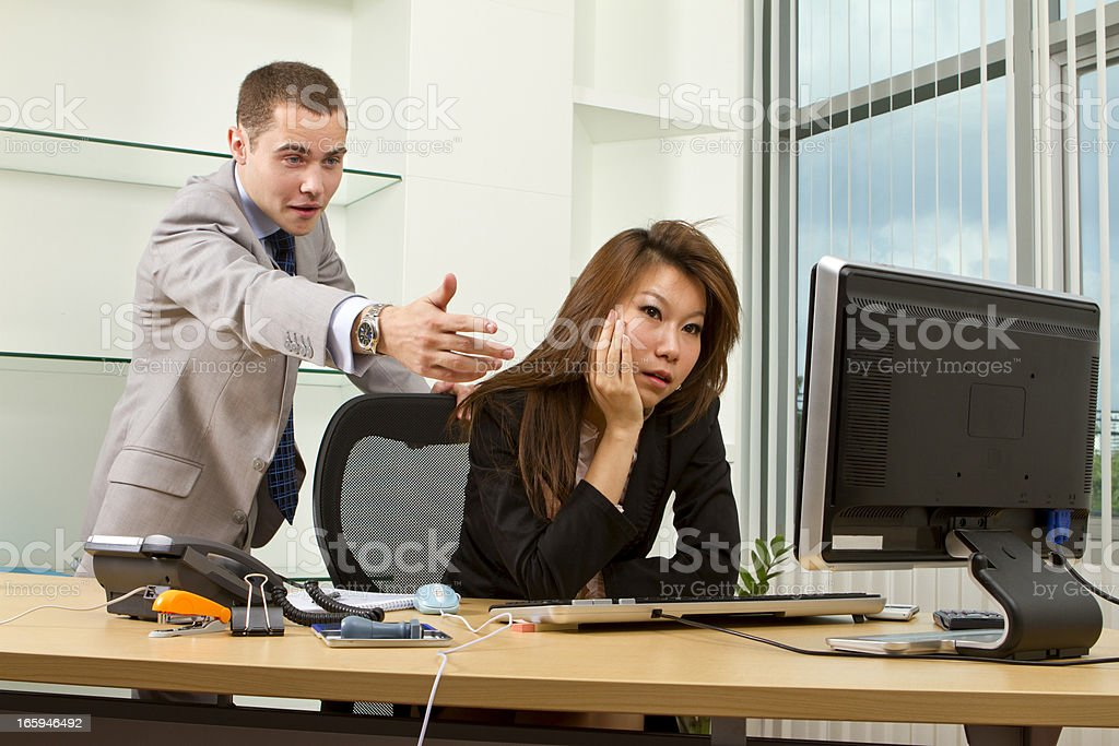 Young manager having an argument with his secretary royalty-free stock photo