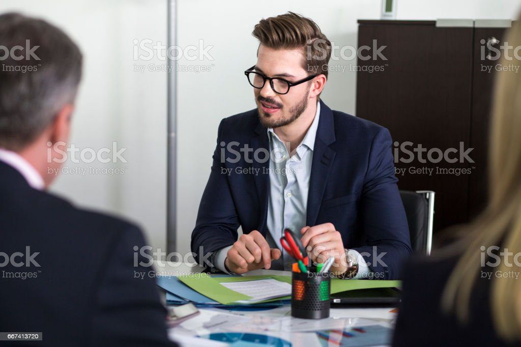 Young manager in meeting stock photo