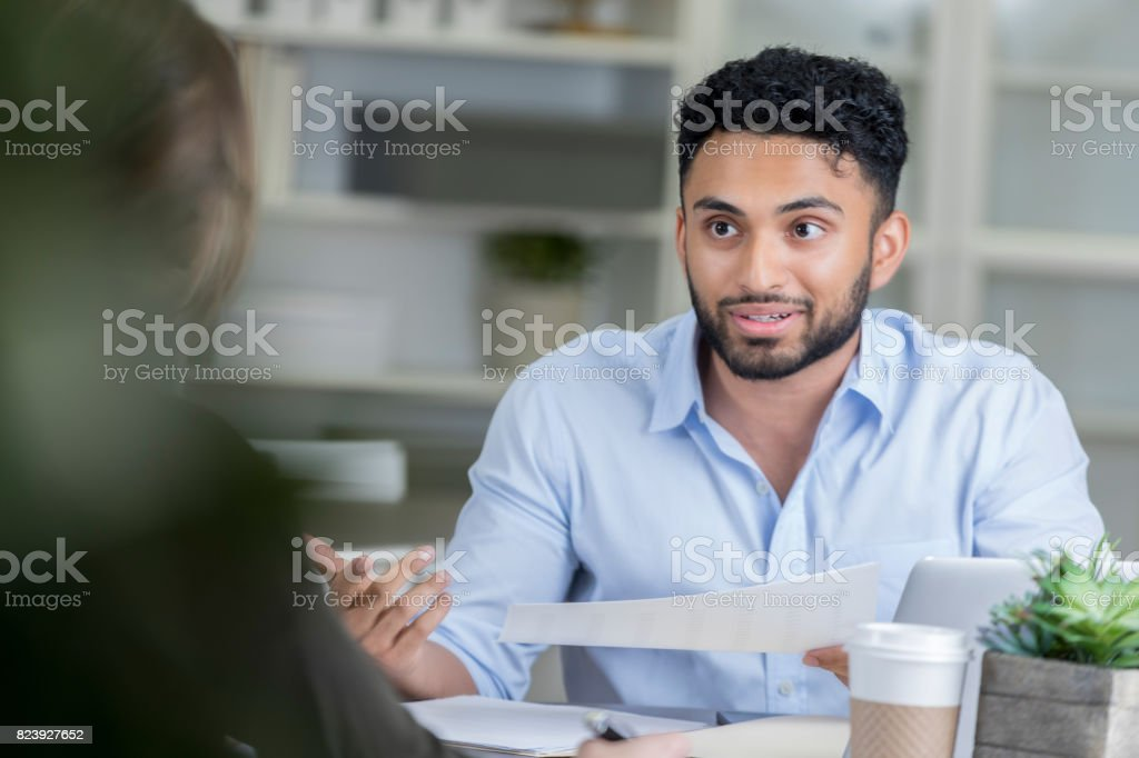 Young manager interviews prospective employee stock photo