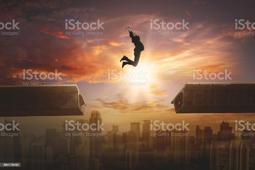 Young manager leaping above the bridge stock photo