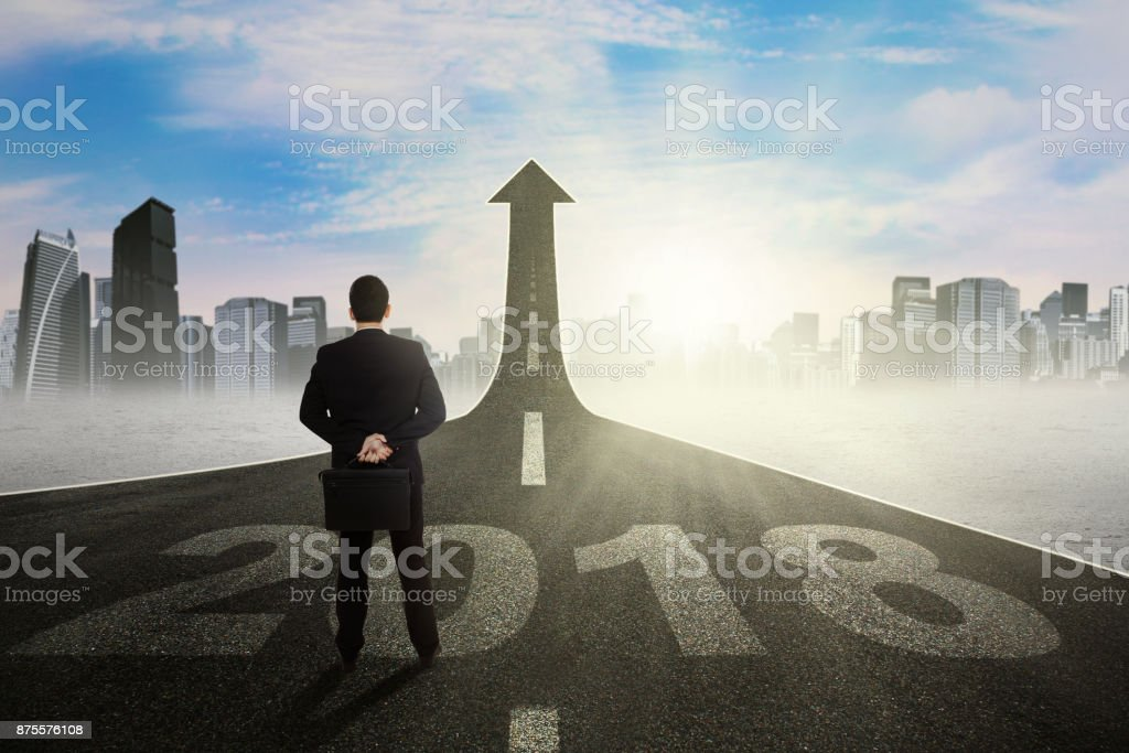 Young manager looking at an upward arrow stock photo