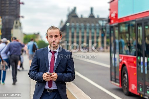 Manager with  smart phone, London, Westminster Bridge