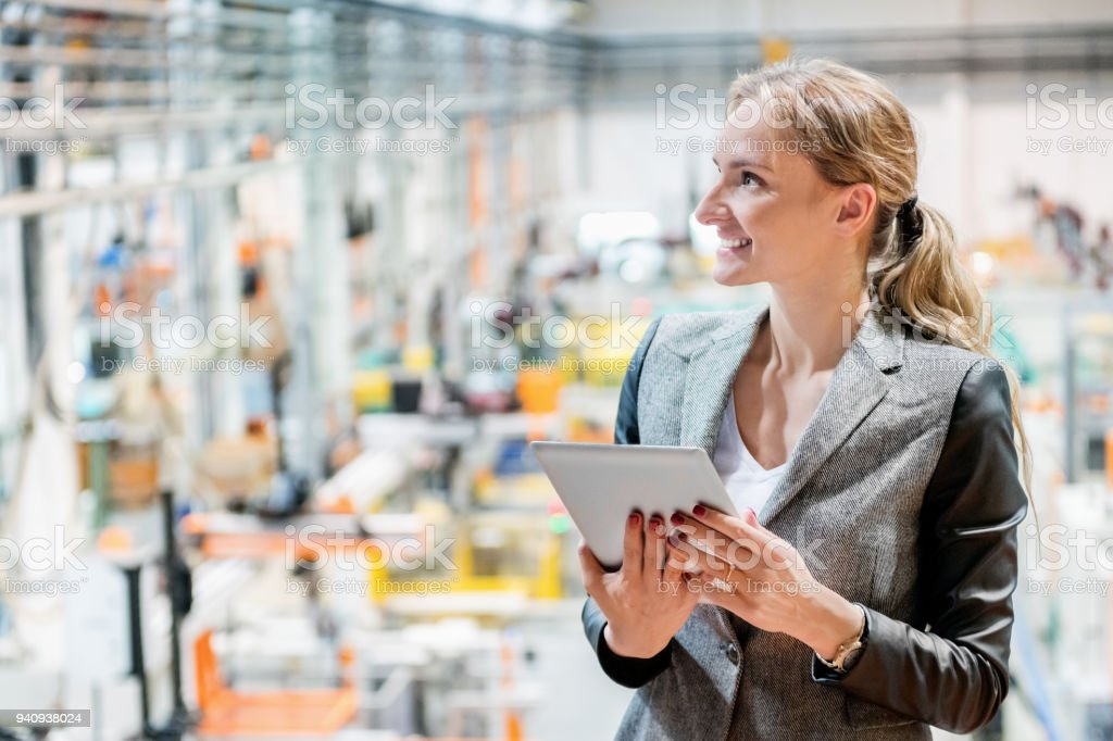 Young manager working in factory stock photo