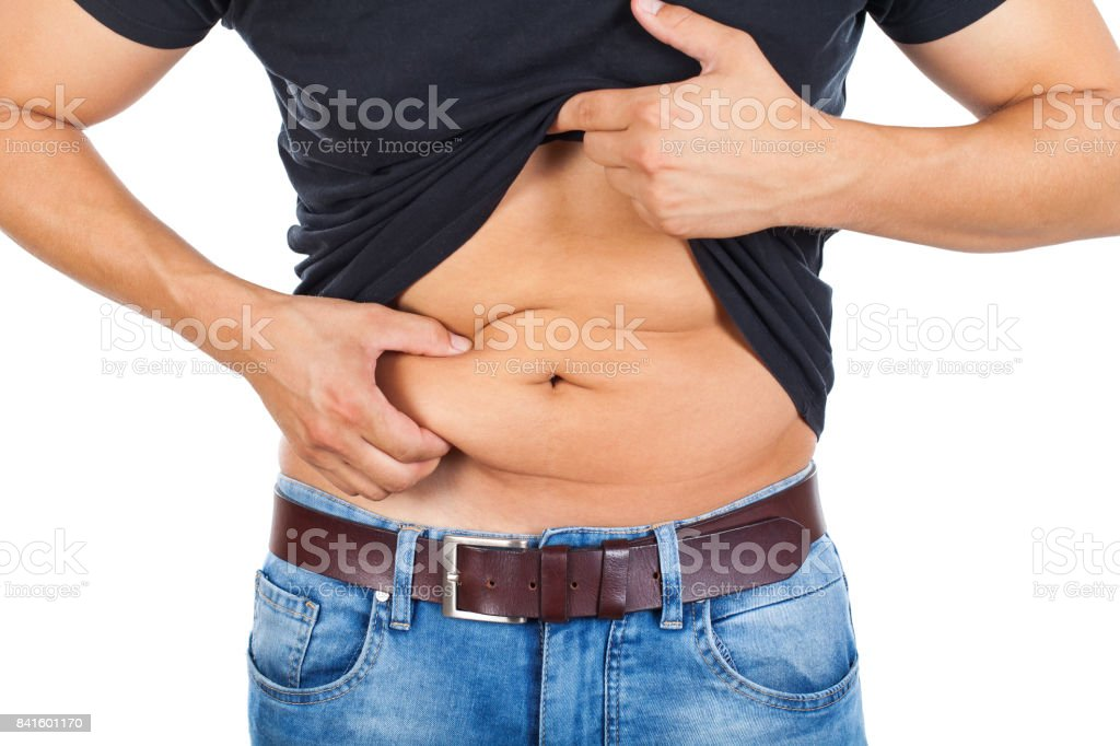 Young man's fatty abdomen royalty-free stock photo