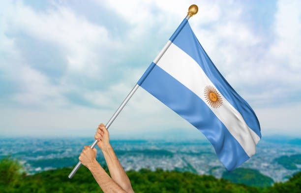 Young man's hands proudly waving the Argentina national flag stock photo