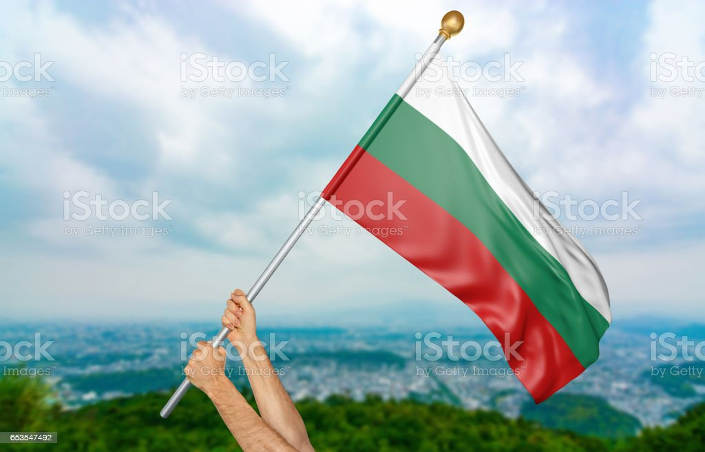 Young man's hands proudly waving the Bulgaria national flag stock photo
