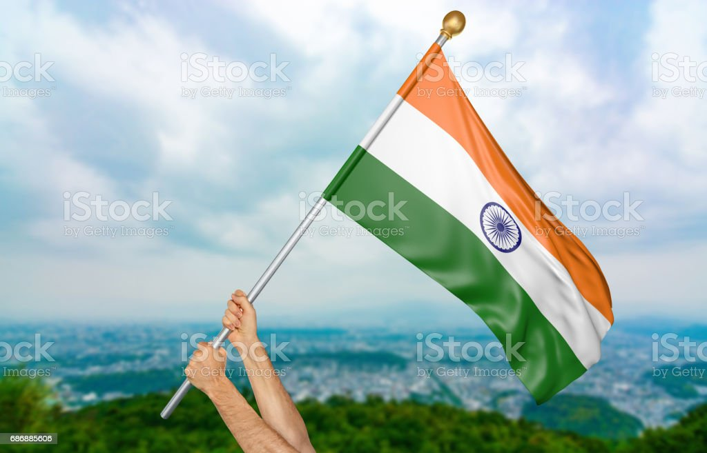 Young man's hands proudly waving the India national flag stock photo